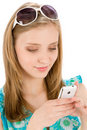 Teenager woman with mobile phone in summer Royalty Free Stock Photo