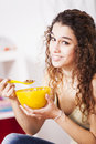 Teenager woman studio happy young eating cereals Royalty Free Stock Photography