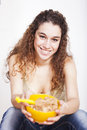 Teenager woman studio happy young eating cereals Royalty Free Stock Images