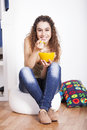 Teenager woman studio happy young eating cereals Stock Photo