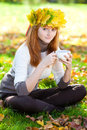 Teenager woman in a wreath of maple leaves with cu Royalty Free Stock Photography