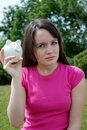 Teenager worried with piggybank Stock Photography