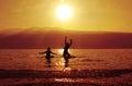 Teenagers, bathing at sundown Royalty Free Stock Photo
