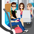 Teenagers commuting by train young sitting talking and communicating with their smartphones Stock Photography