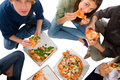 Teenagers eating pizza isolated on white background Royalty Free Stock Photography