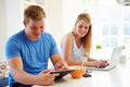 Teenagers Having Breakfast Using Laptop And Tablet Computer Royalty Free Stock Photo