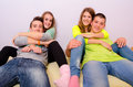 Teenagers having fun at home while sitting on bed Royalty Free Stock Photography