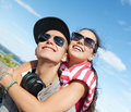 Teenagers having fun outside summer holidays and teenage concept Royalty Free Stock Photo