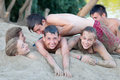 Teenagers having fun on the sandy beach Stock Photography