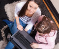 Teenagers with laptop at home Royalty Free Stock Photo