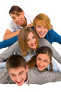 Teenagers laying in pile Royalty Free Stock Images