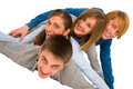 Teenagers laying in pile on white background Royalty Free Stock Photo