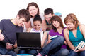 Teenagers looking at laptop Royalty Free Stock Photo