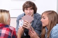 Teenagers playing cards together home Royalty Free Stock Photo