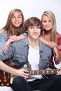 Teenagers playing the guitar together Stock Image