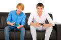 Teenagers playing with playstation isolated on white background Stock Images