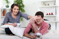 Teenagers playing video game. Royalty Free Stock Photo