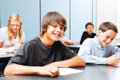 Teenagers in school class of focus on suntanned boy the front Stock Images