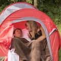 Teenagers share a small red tent Royalty Free Stock Photo