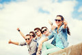 Teenagers showing thumbs up summer holidays and teenage concept group of Stock Photos