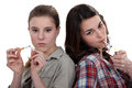 Teenagers smoking a Royalty Free Stock Image