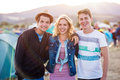 Teenagers at summer music festival, sunset Royalty Free Stock Photo