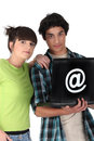Teenagers surfing the net Stock Photos