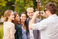 Teenagers taking photo outside summer holidays and teenage concept group of Stock Photos