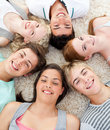 Teenagers with their heads together smiling Royalty Free Stock Photography