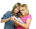 Teenagers using tablet PC Stock Image
