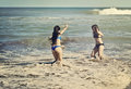 Teenagers in the water two playing a beach of mar del plata argentina Royalty Free Stock Image