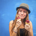 Teengirl with ice cream, blue wall background (Instagram style series) Royalty Free Stock Photo