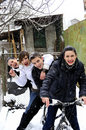 Teens on bicycle in winter season Royalty Free Stock Photo