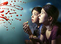 Teens boy and girl watching horror movie film Royalty Free Stock Photo