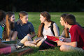 Teens Doing Homework Outdoors Royalty Free Stock Photo