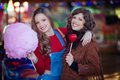 Teens at fair with candy floss and toffee apple Stock Images