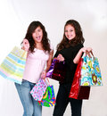 Teens with gift bags Royalty Free Stock Photography