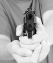 Teens hand with gun Stock Photography