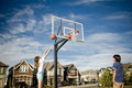 Teens having fun playing basketball Stock Photo