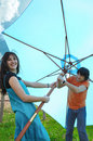 Teens holding big umbrella Royalty Free Stock Photo
