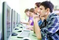 Teens in internet-cafe Royalty Free Stock Photo