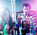Teens at party doing drugs photo of two with giant bong Royalty Free Stock Photography