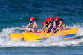 Teens Ride On Banana Boat Stock Image