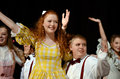 Teens in a school play group of children period clothing during theater performance of the music man north forsyth high feb Stock Image