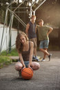 Teens teen girl with basketball her friends on the background Stock Images