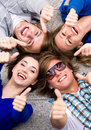Teens With Thumbs Up Stock Photo