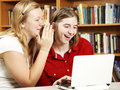 Teens Whisper and Web Surf Stock Photography