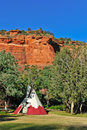 Teepee by trees and red rocks Stock Photo