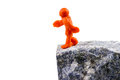 Teeter on the brink of the abyss self made human plasticine figure walking to edge Royalty Free Stock Image