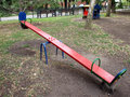 Teeter red color on the playground closeup diagonal image there is no one Royalty Free Stock Photography